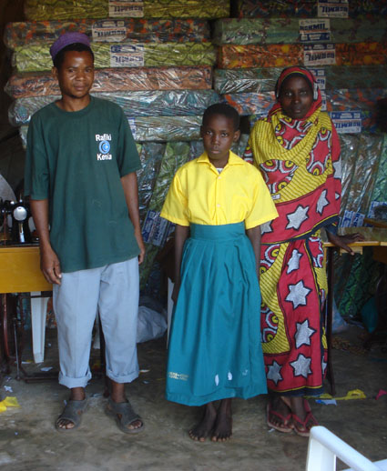Teacher, student and child for whom she made a schooluniform